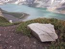 An image of Yeso Lake (Embalse Yeso) with a gypsum stone in the foreground.